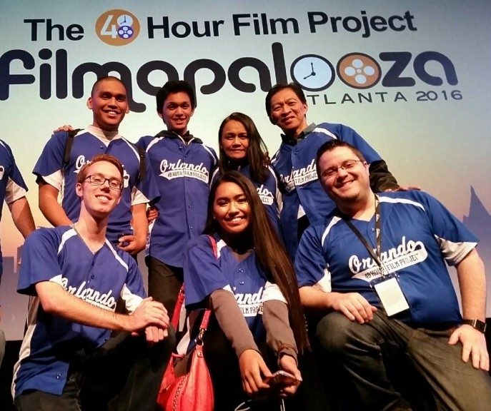 Joshua Ortiz (top row, left) is accompanied by his family and fellow filmmakers, including cinematographer Austin Burke (bottom row, far left) and Orlando City Producer Kyle Snavely (bottom row, far right).