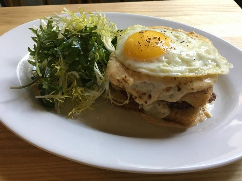 Croque madame with frisee salad. - PHOTO COURTESY DOVECOTE.
