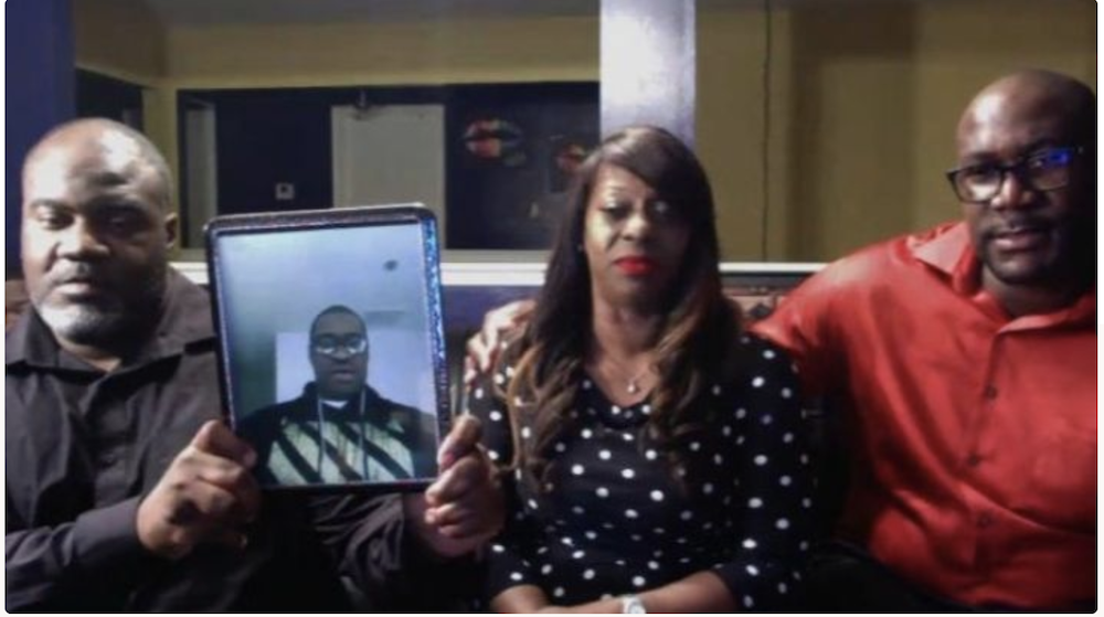 Floyd family with a picture of George Floyd who was a victim of police brutality - PHOTO VIA GEORGE FLOYD MEMORIAL FUND/GO FUND ME