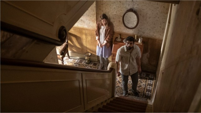 Tomas prepares to go upstairs and check on Magda's mother, who is locked in a room and dying. Trust us, that's not a good idea. - NICK WALL/MAGNET RELEASING