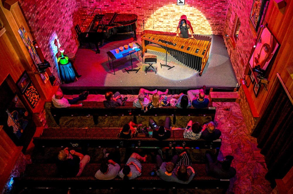 Bird's-eye view from the top balcony of percussionist Britton-René Collins playing Timucua's 1,000th show - PHOTO BY JIM LEATHERMAN