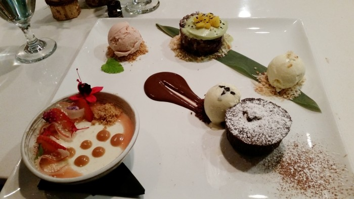 17. Dessert plate of mango sticky rice, flourless chocolate cake with dulce de leche filling, panna cotta with rhubarb gelee, coconut ice cream, strawberry-rhubarb ice cream