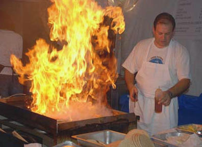 The only thing better than cheese is flaming cheese. - PHOTO COURTESY ORLANDO GREEK FEST