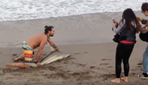 Watch this Florida manbun use a shark as a selfie prop