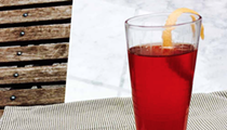Summertime calls for adding sparkling rośe and ruby-red grapefruit to your negroni