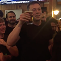 Here's Elon Musk drinking a beer at a bar in Port Canaveral after the SpaceX Falcon Heavy launch