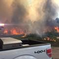 Fire crews fight 300-acre brush fire near International Drive