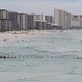 80 people form human chain to save family at Florida beach