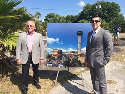 US Thrill Rides' Bill and Michael Kitchen with the Skycraper concept art.