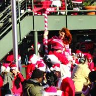 Hundreds of Santas descend on Thornton Park