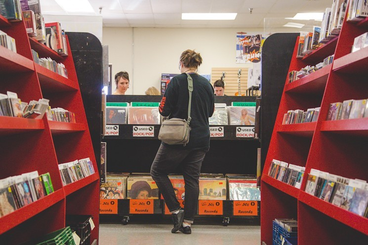 Customers browsing at Zia Records on Mill Avenue in Tempe. - JACOB TYLER DUNN