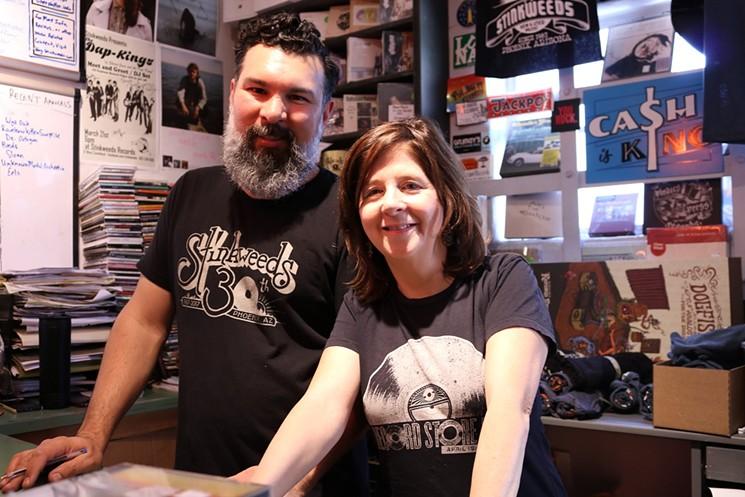 Dario Miranda (left) and Kimber Lanning enjoying a pre-pandemic Record Store Day at Stinkweeds. - MICHELLE SASONOV