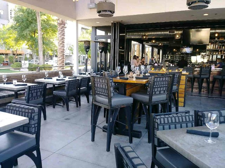 Grab a seat on the patio. Then get ready to travel the globe. - MATCH MARKET & BAR