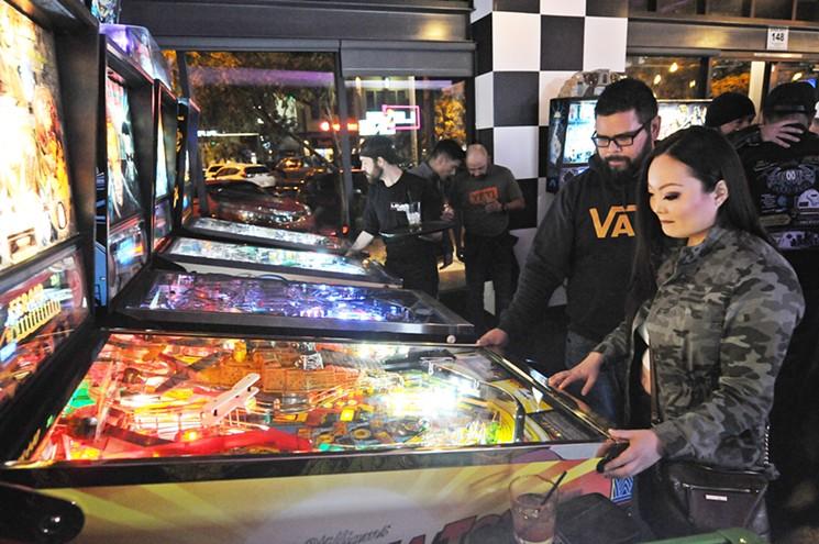 Pinball action at the original Level 1 Arcade Bar in Gilbert. - BENJAMIN LEATHERMAN