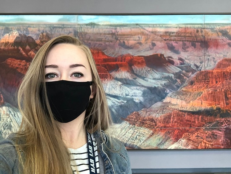 Haley Hinds took this selfie with Merrill Mahaffey's Grand Canyon landscape in Terminal 3. - HALEY HINDS