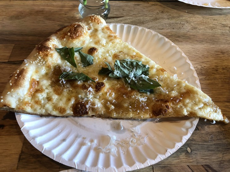 Some of the better white pizza in town, from Via Della slice. - CHRIS MALLOY