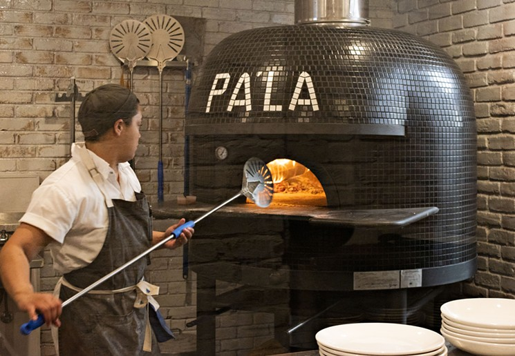 Peeling pizza and bread from the Pa'La Downtown wood-fired oven. - JM PHOTO