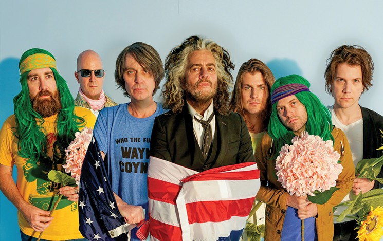 Wayne Coyne (center) and company are headed back to the Valley. - WARNER BROS. RECORDS