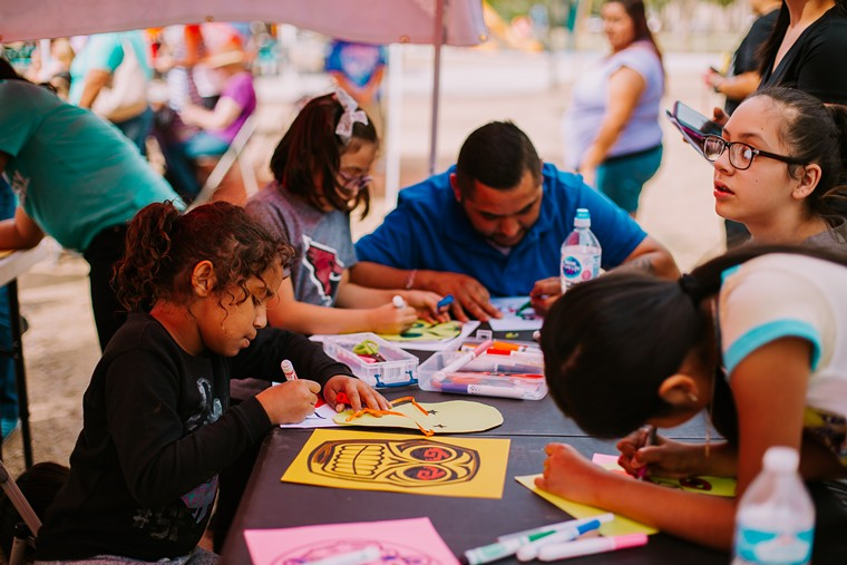 Families making mask-inspired artworks. - CULTURAL COALITION