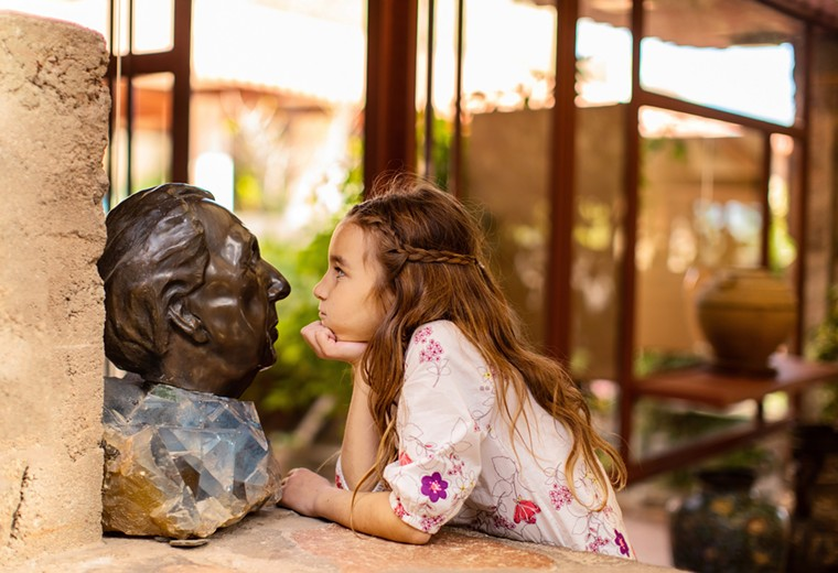 A student checks out a bust of famed architect Frank Lloyd Wright. - JILL RICHARDS