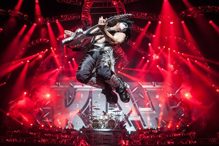 Paul Stanley catches some air during a 2016 concert by KISS in Phoenix. - JIM LOUVAU