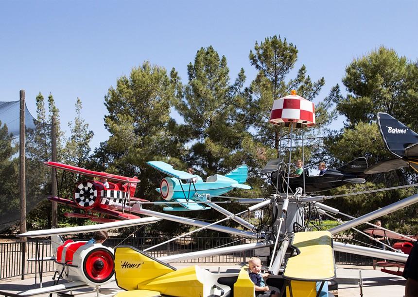 Children enjoy the Flying Farmers ride at Schnepf Farms. - AMANDA MASON