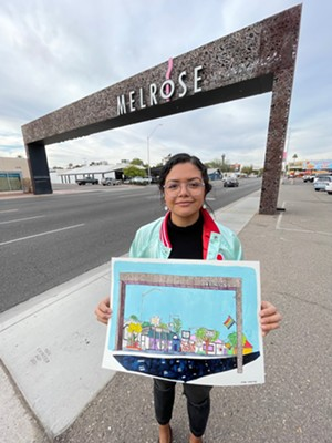 Martinez shows off her depiction of the Melrose neighborhood gate. - AILEEN MARTINEZ