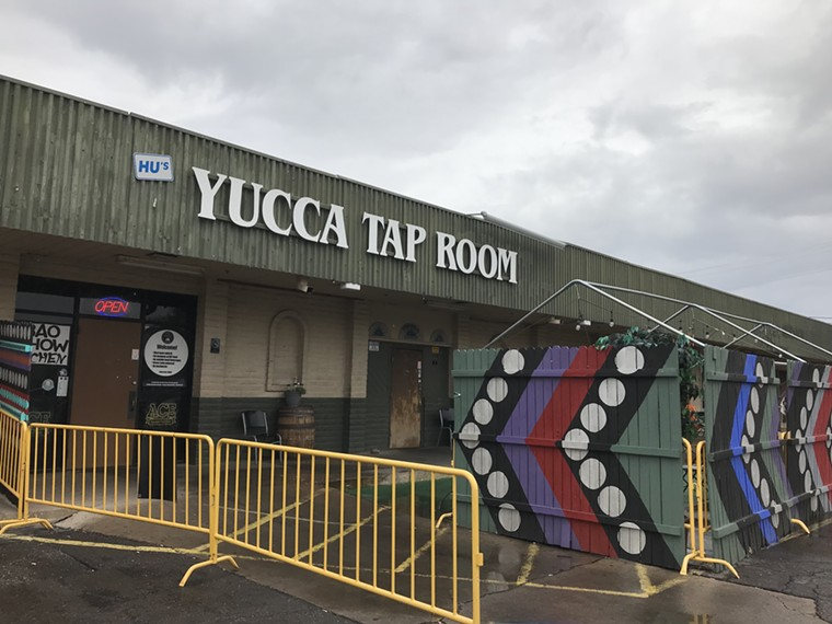 Entrance to Yucca Tap Room, with art by Kyllan Maney, at Danelle Plaza. - LYNN TRIMBLE