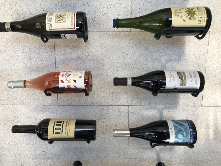 Low-intervention wine bottles on the sound-absorbent cork wall at Sauvage. - CHRIS MALLOY