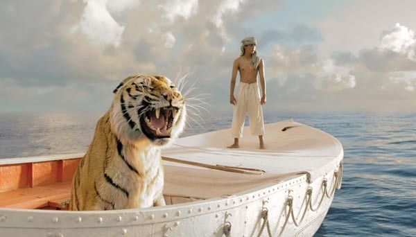 A boy (Suraj Sharma) and a tiger, afloat together