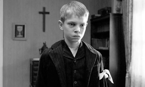A ribbon for reminder: The pastor's son (Leonard Proxauf) wears the mark of purity around his arm.