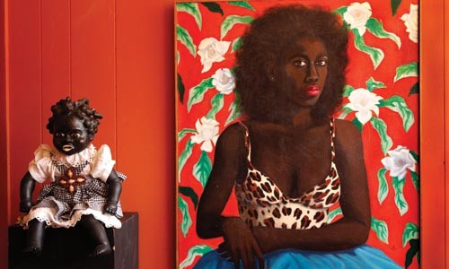 A sculpture by Vanessa German (left) and a painting by Renee Stout.