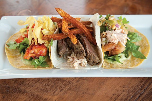 "A selection of tacos: barbequed shrimp, ""Pittsburgh taco"" and beer-battered cod"