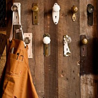 Butcher and the Rye A server's apron hangs from hooks made of reclaimed vintage doorknobs. Photo by Heather Mull