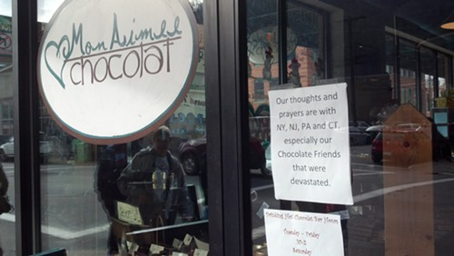 A sign on the door of a chocolate shop in the Strip District.