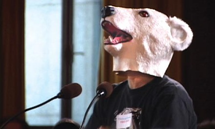Activists wore masks to make a point to city council.