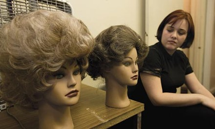 Actor Jessica Kennedy eyes wigs for her dual role as Myra/Myrna in Open Stage Theatre's production of The Mineola Twins. - HEATHER MULL