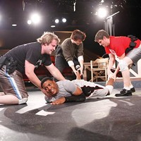 Actors playing police officers stage a fight scene with Corey Talley (center), as Jonny Gammage.
