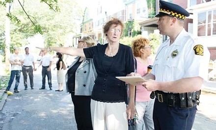 Aggie Brose, deputy director of the Bloomfield-Garfield Corporation, speaks with Lt. Kevin Kraus of Pittsburgh Police Zone 5, during a code sweep by the BGC's public-safety task force on June 10. - HEATHER MULL