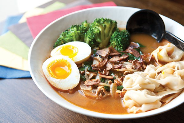 Ajo-ramen with garlic, sliced pork, broccoli, egg, wontons, chives, green onion and crushed red pepper