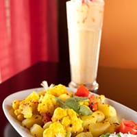 All India Aloo Gobi and mango lassi. Photo by Heather Mull