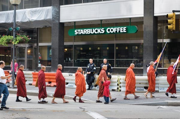 """Burmese Monks and Starbucks"" (2009), by Mark Perrott."