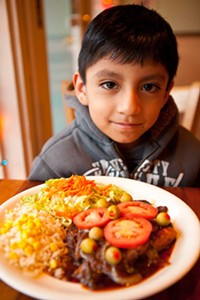 Angel Navarrete with tilapia veracruz - PHOTO BY HEATHER MULL