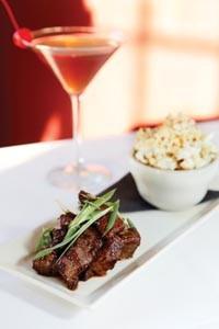 Asian steak bites, served with truffle-oil popcorn - HEATHER MULL
