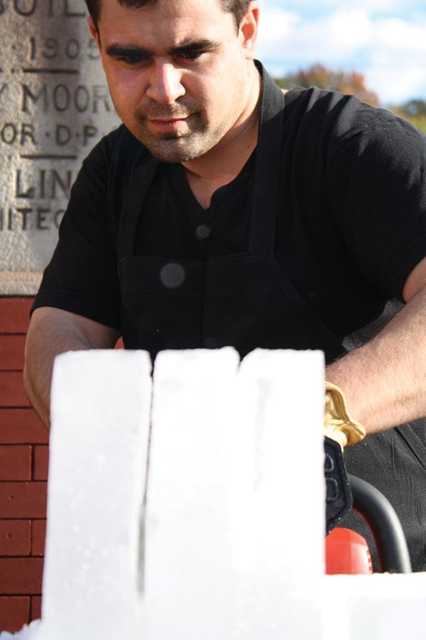 Bar Marco owner Bobby Fry cuts ice, a skill he learned in Washington, D.C.