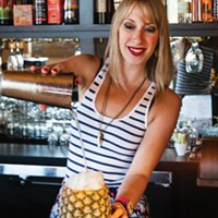 Bartender Sarah Clarke assembles a one-of-a-kind cocktail at Tender.