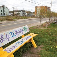 Beautification efforts along Larimer Avenue include this painted bench on the site of the community garden.