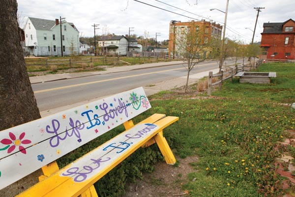 Beautification efforts along Larimer Avenue include this painted bench on the site of the community garden. - PHOTO BY HEATHER MULL