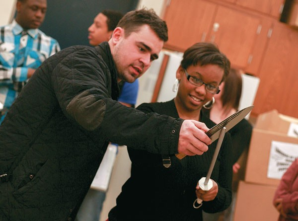 Bobby Fry teaches a student how to sharpen her knife.