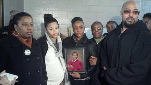 Brandi Fisher, president of the Alliance for Police Accountability, stands with members of Leon Ford Jr.s family at the St. Lawrence OToole Center in East Liberty Wednesday morning. Family included Avery Roberts, who is due to deliver Fords child in January; Fords mother, Latonya Green; his grandmother, Marion Green; and his father, Leon Ford Sr.